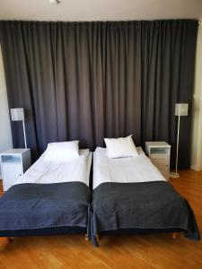 Säng eller sängar i ett rum på Åhus Bed & Breakfast