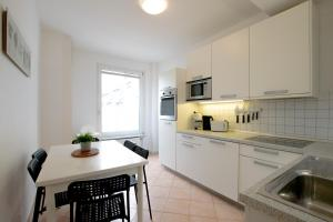 A kitchen or kitchenette at Tolstov-Hotels Old Town Apartment