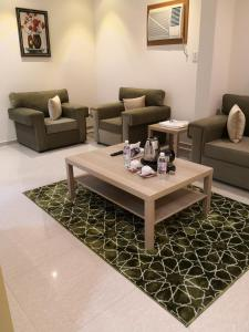 A seating area at Roh Al Aseelah Furnished Units