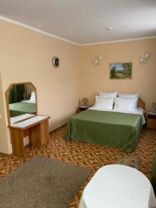 Кровать или кровати в номере Гостевой дом Bellissimo