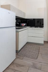A kitchen or kitchenette at aestatisdomus