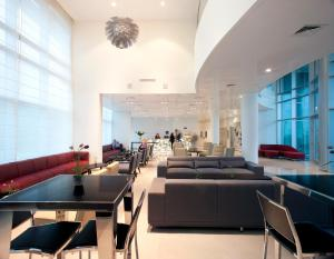 A seating area at West All Suites Hotel Ashdod