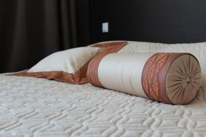 A bed or beds in a room at Aquilonis Hotel