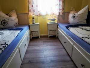 Ein Bett oder Betten in einem Zimmer der Unterkunft Bungalow am See