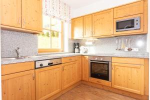 A kitchen or kitchenette at Appartementhaus Schützenhof Schied