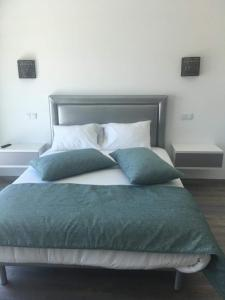 A bed or beds in a room at Primo dos caracois