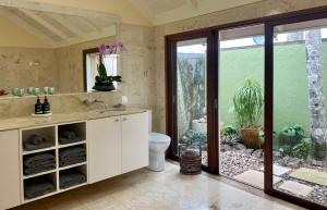 A bathroom at Four Winds Luxury Villas Byron Bay