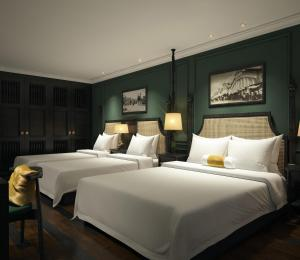 A bed or beds in a room at Hanoi Ancient Paradise Hotel & Travel