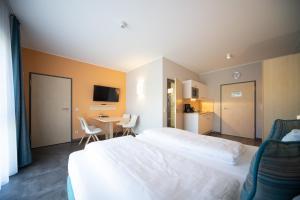 Ein Bett oder Betten in einem Zimmer der Unterkunft Riff Resort