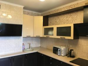 A kitchen or kitchenette at Двухкомнатные апартаменты на Талсинской