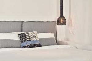 Ένα ή περισσότερα κρεβάτια σε δωμάτιο στο Boho Suites