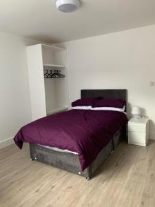 A bed or beds in a room at Rufford Lodge