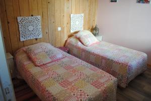 Un ou plusieurs lits dans un hébergement de l'établissement Chambres d'hôtes de la Cavayere & Spa