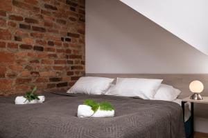 A bed or beds in a room at Fani&Rozi B&B