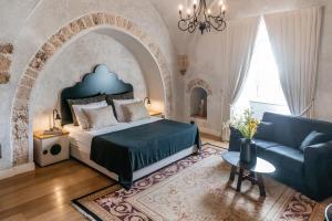 Ein Bett oder Betten in einem Zimmer der Unterkunft Casa Nova - Luxury Suites & Boutique Apart-Hotel