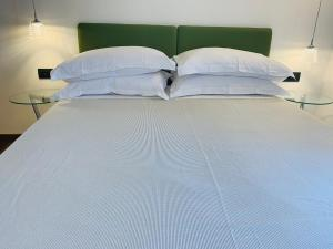 A bed or beds in a room at Albergo Ristorante Paradiso