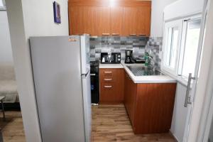 A kitchen or kitchenette at Blue Coast 1