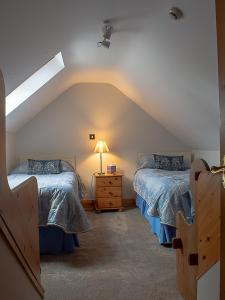 A bed or beds in a room at Lis-Ardagh Lodge