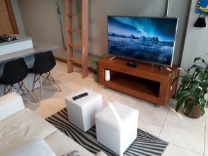 A television and/or entertainment centre at Loft, conforto e praticidade.