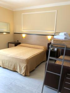 A bed or beds in a room at Hotel Tirrenia