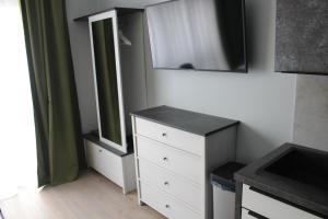 Telewizja i/lub zestaw kina domowego w obiekcie Apartamenty Jagiellońska 23