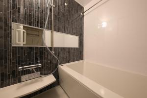 A bathroom at TAKUTO STAY OSAKA UEHOMMACHI