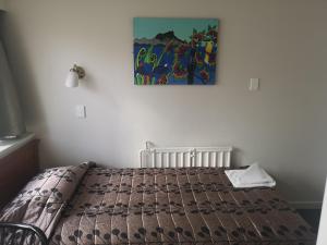 Кровать или кровати в номере Kiwi International Hotel