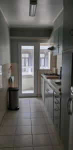 A kitchen or kitchenette at Apartment Hertstraat