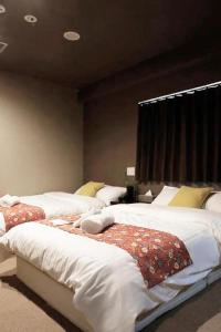 A bed or beds in a room at Sumiya Spa & Hotel