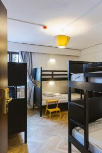 A bunk bed or bunk beds in a room at Grand Hostel