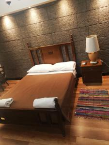 A bed or beds in a room at Kipros Accommodation