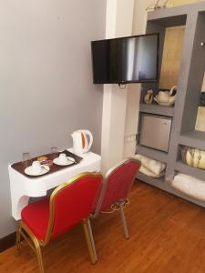 A television and/or entertainment center at Kipros Accommodation