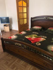A bed or beds in a room at Guest House on Oktyabrskaya 19