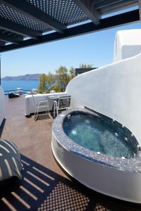 The swimming pool at or near Oia Suites