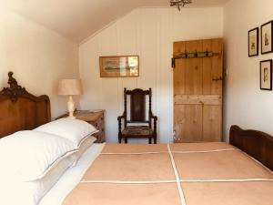 A bed or beds in a room at Lower Crankan Farm