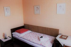 Postel nebo postele na pokoji v ubytování Hotel Panský Dům Žamberk