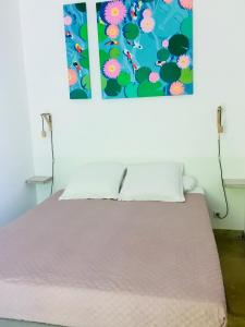A bed or beds in a room at L'Islo Bamboo