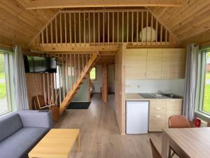 A kitchen or kitchenette at Hörgsland Cottages