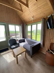 A seating area at Hörgsland Cottages