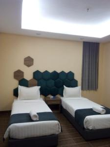 A bed or beds in a room at Shahad Al Taif
