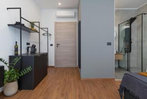 A kitchen or kitchenette at Deluxe Rooms and Apartments Korzo
