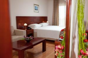 Postel nebo postele na pokoji v ubytování Apartments Agava