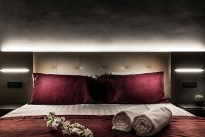 A bed or beds in a room at Hotel Varese