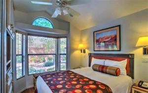 A bed or beds in a room at Sedona Pines Resort