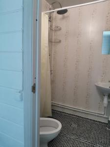 Ванная комната в Gostevie Doma Fortuna