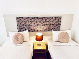 A bed or beds in a room at Greenmount Beach House