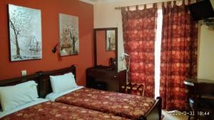 Ein Bett oder Betten in einem Zimmer der Unterkunft Palatino