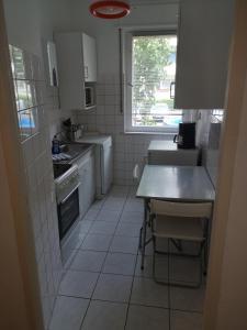 A kitchen or kitchenette at M M Central Vintage Family, Handwerker und Monteure Apartments