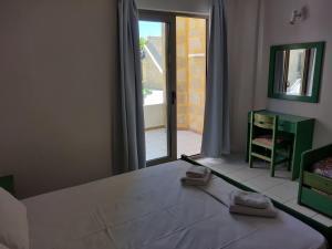 Letto o letti in una camera di Viglia Beach Apartments