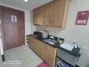 A kitchen or kitchenette at Shell Residences